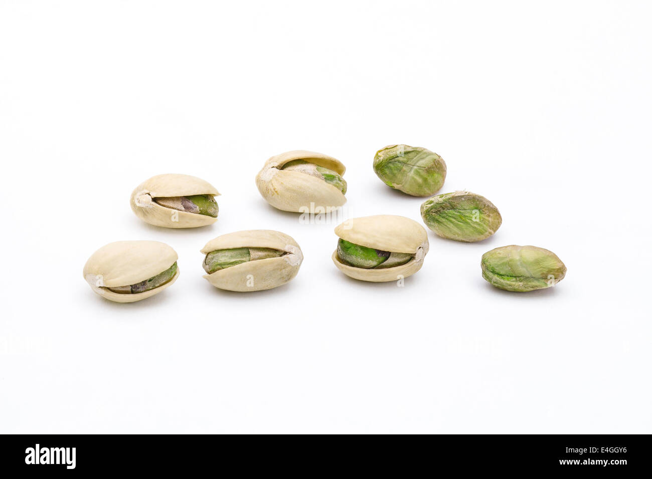 Pistachio nuts and seeds isolated on white background - Stock Image