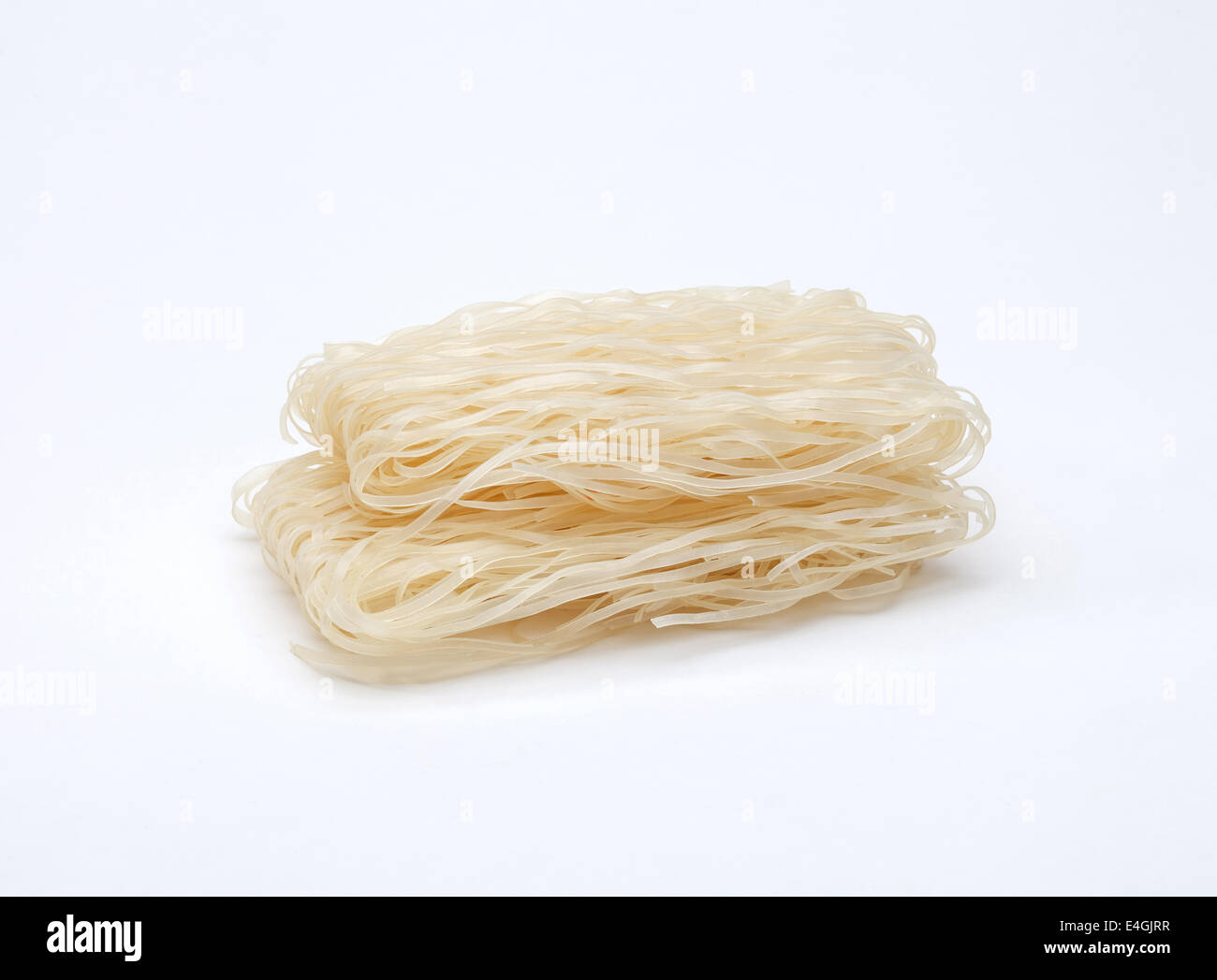 Instant asian style dried brown rice noodles isolated on white background - Stock Image