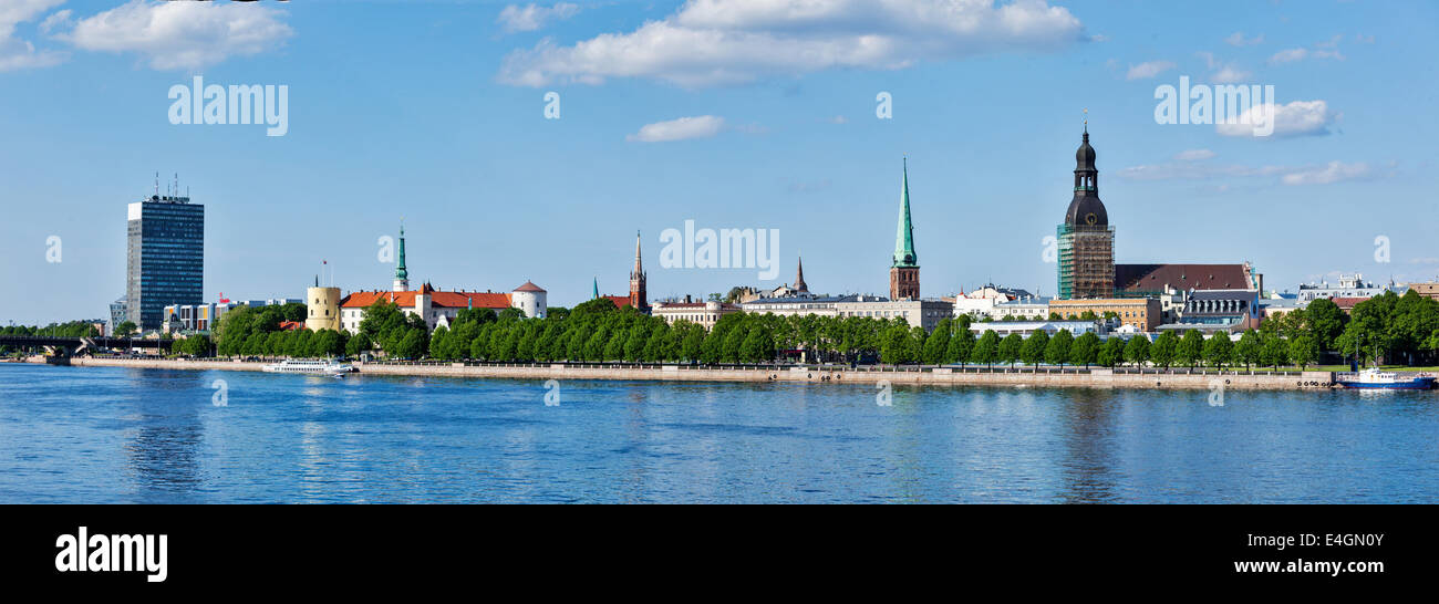 Panorama of Riga over Daugava river: Riga Castle, St. James's Cathedral, Riga Cathedral, St. Peter's Church - Stock Image
