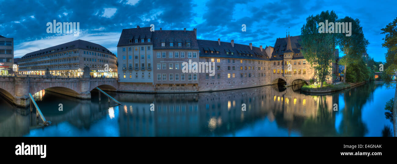 Nuremberg panorama at night along the river Pegnitz from the Museumsbrücke to the Heilig-Geist-Spital. Stock Photo