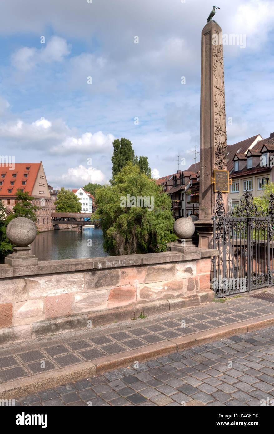 The ancient Karlsbruecke (Karls Bridge) looking towards the wooden Henkersteg (Hangman's Bridge) and the river Pegnitz Stock Photo