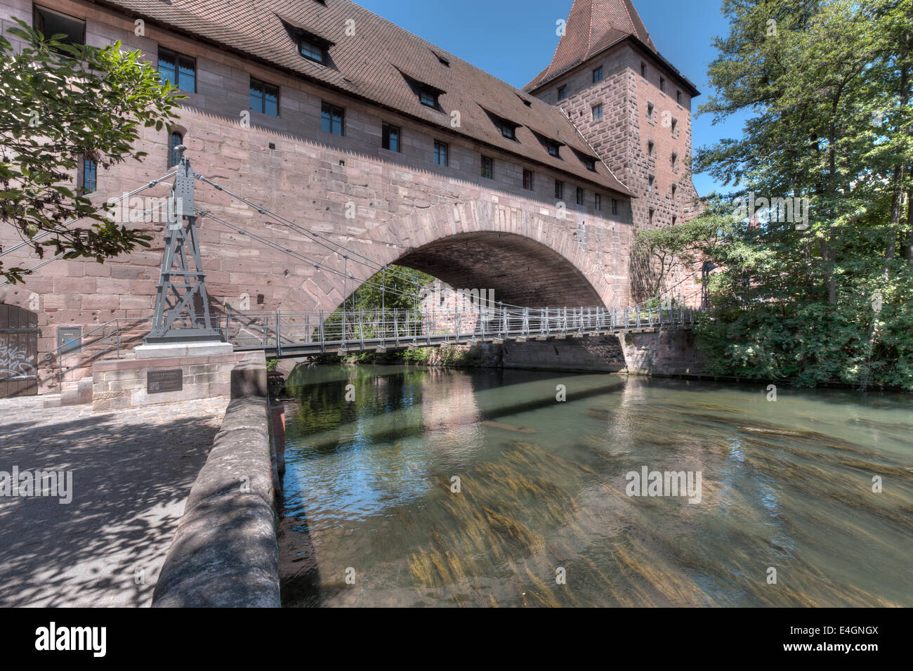 The River Pegnitz in Nuremberg, with the city wall, Schlayenturm and the Kettensteg (Chain Bridge) Stock Photo