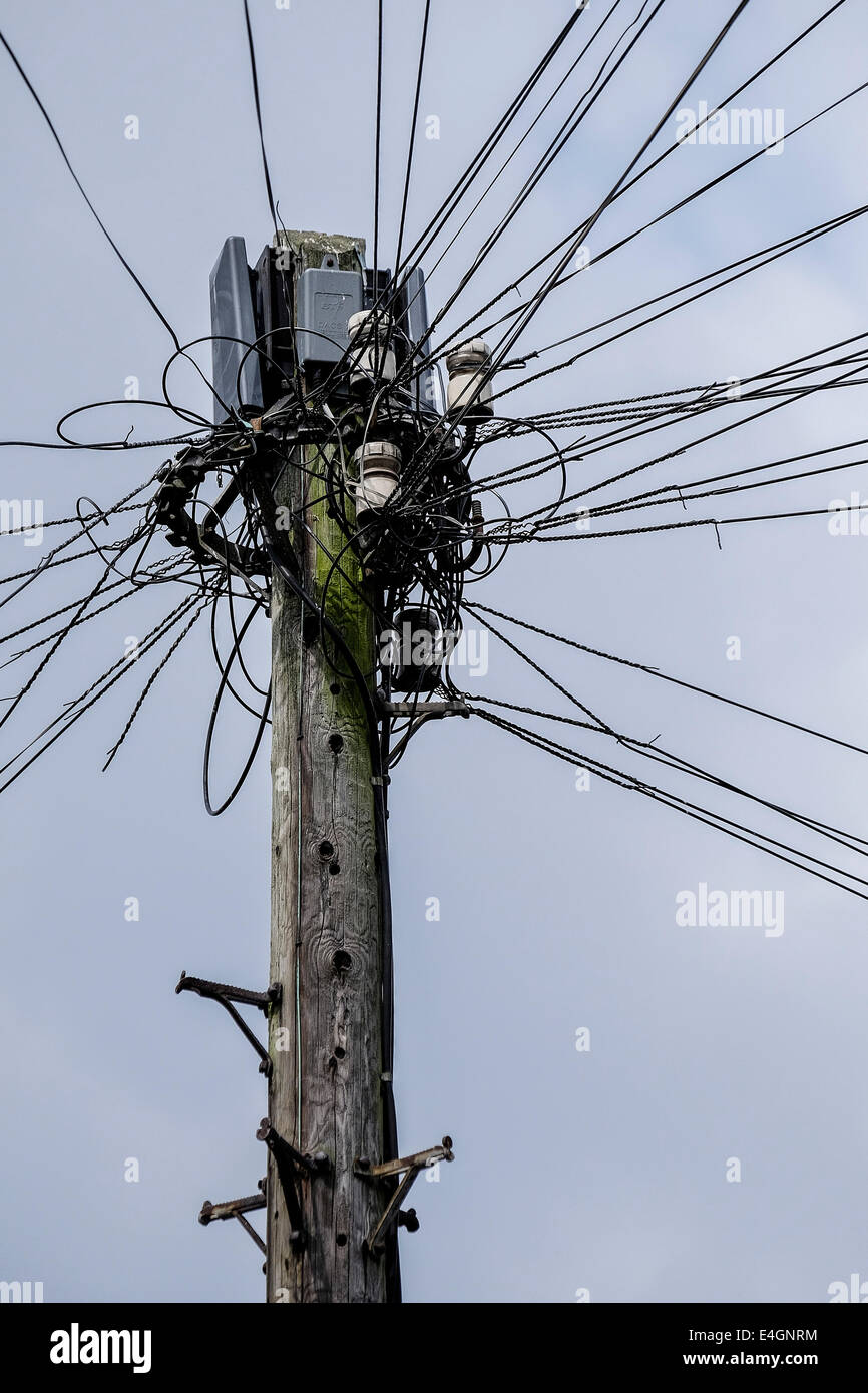 A telegraph pole with telephone wires. - Stock Image