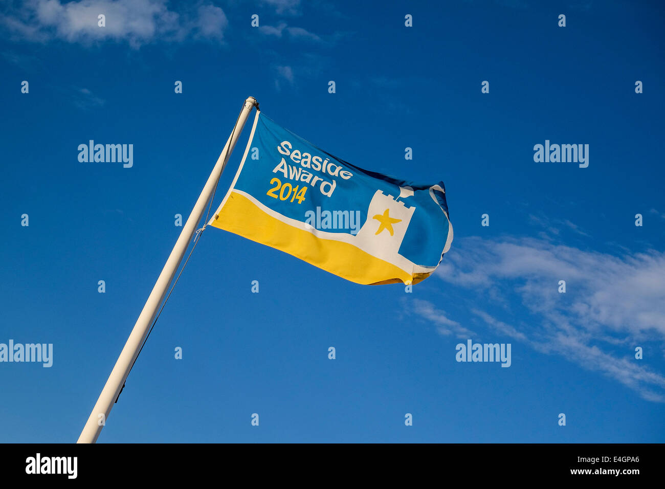 A Seaside Award flag awarded to Jubilee Beach in Southend. - Stock Image