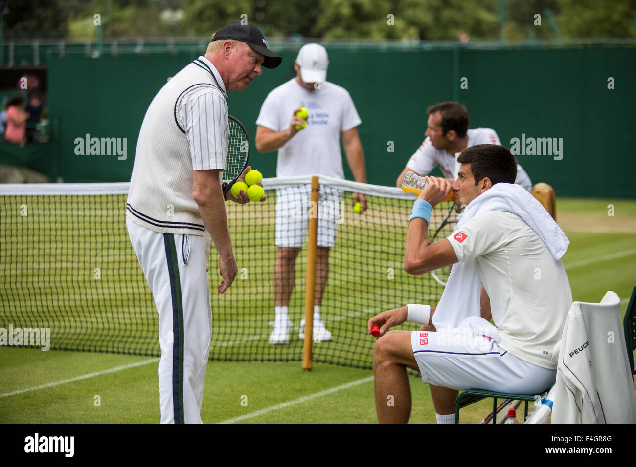 Boris Becker (left) coaches Novak Djokovic (right) as he practices on Court no.4  The Championships Wimbledon 2014 - Stock Image