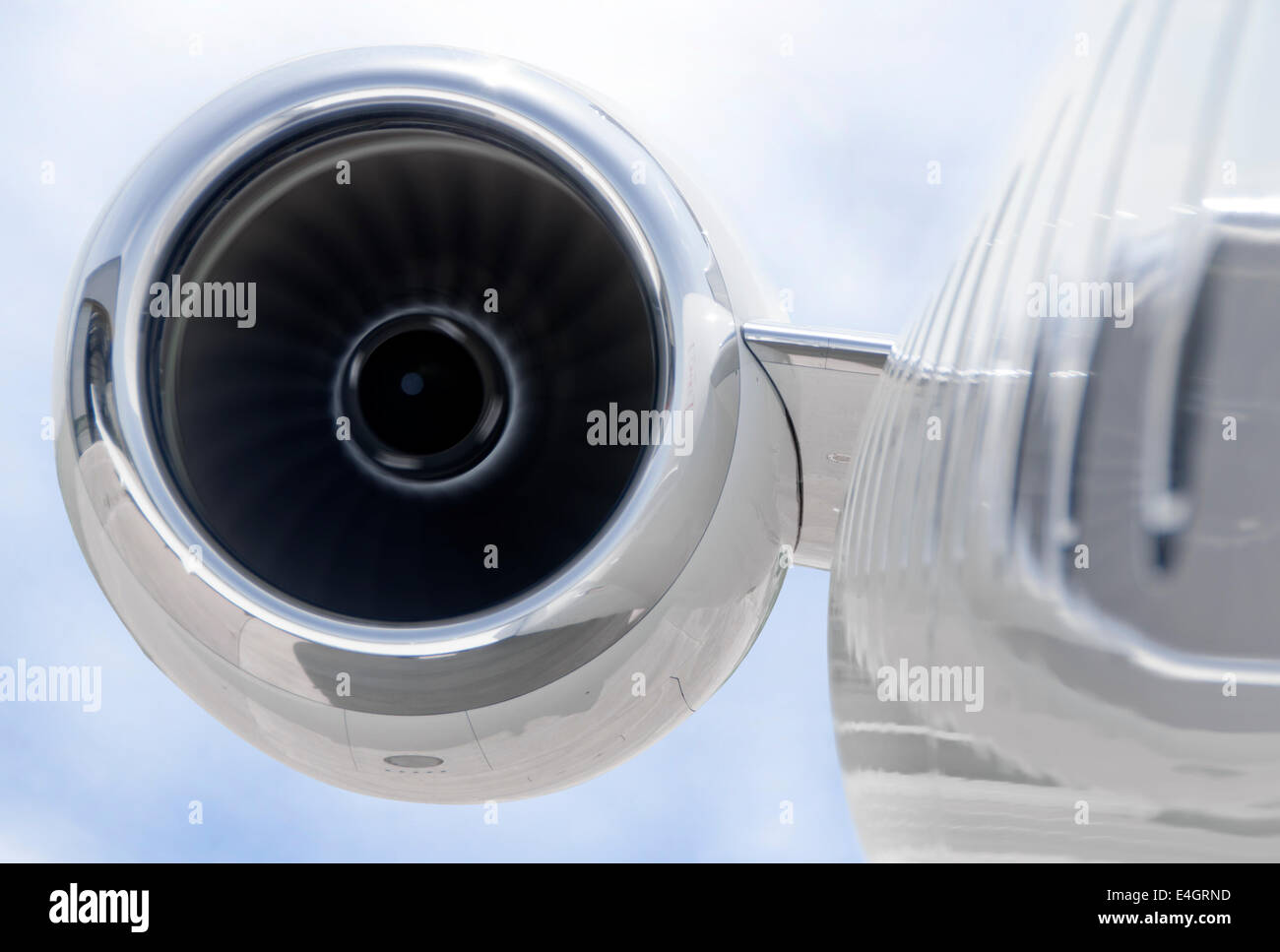 Running Jet Engine closeup on a modern private jet airplane - Bombardier Global Express - Stock Image