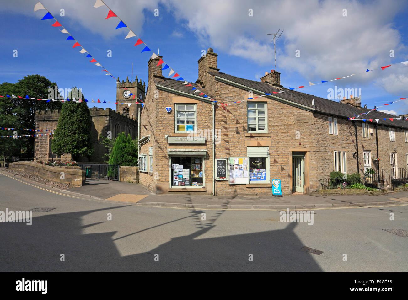 Village store and St Matthew's Church in Hayfield, Derbyshire, England, UK. - Stock Image
