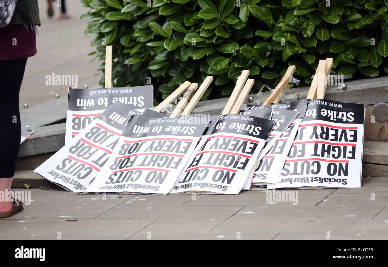 Swansea, UK. 10th July, 2014.  Pictured: Socialist Workers placards reading 'No Cuts Fight for Every Job) at - Stock Image