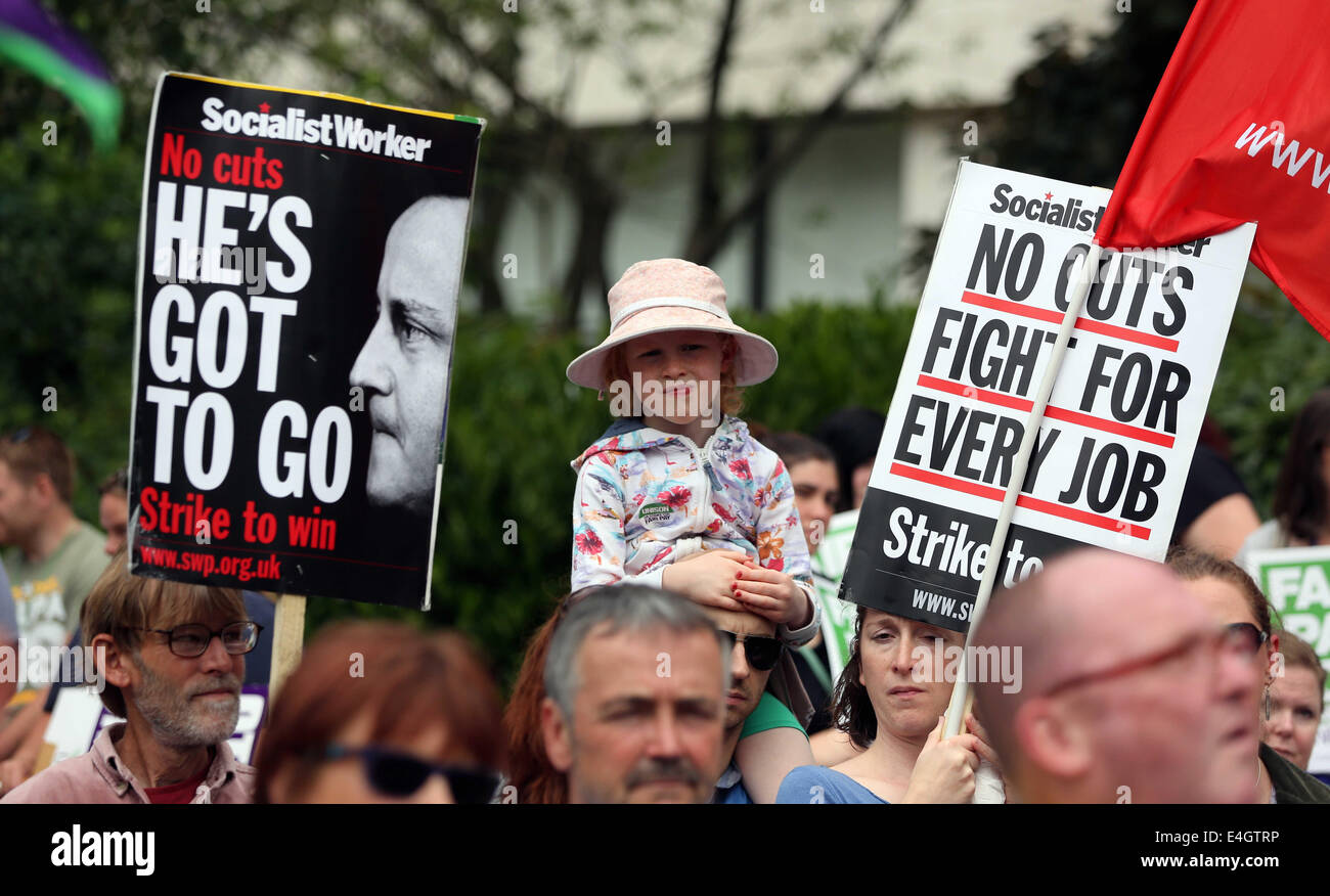 Swansea, UK. 10th July, 2014.  Pictured: A young girl among two Socialist Workers placards one reading 'No Cuts - Stock Image