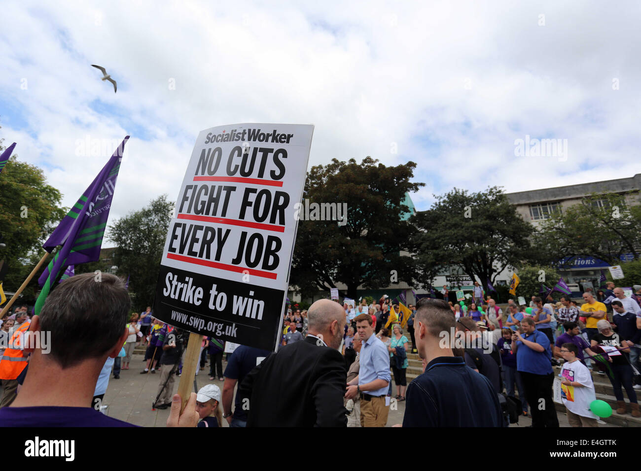 Swansea, UK. 10th July, 2014.  Pictured: A Socialist Workers placard reading 'No Cuts Fight for Every Job' - Stock Image