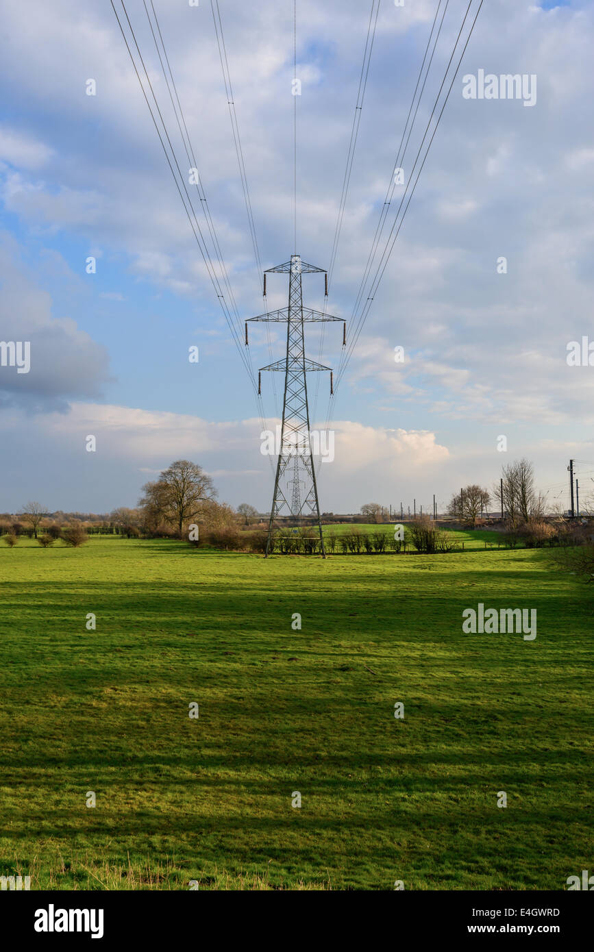 Obsolete old design L6 Series suspension tower in a rural Yorkshire field, part of the National Grid. - Stock Image