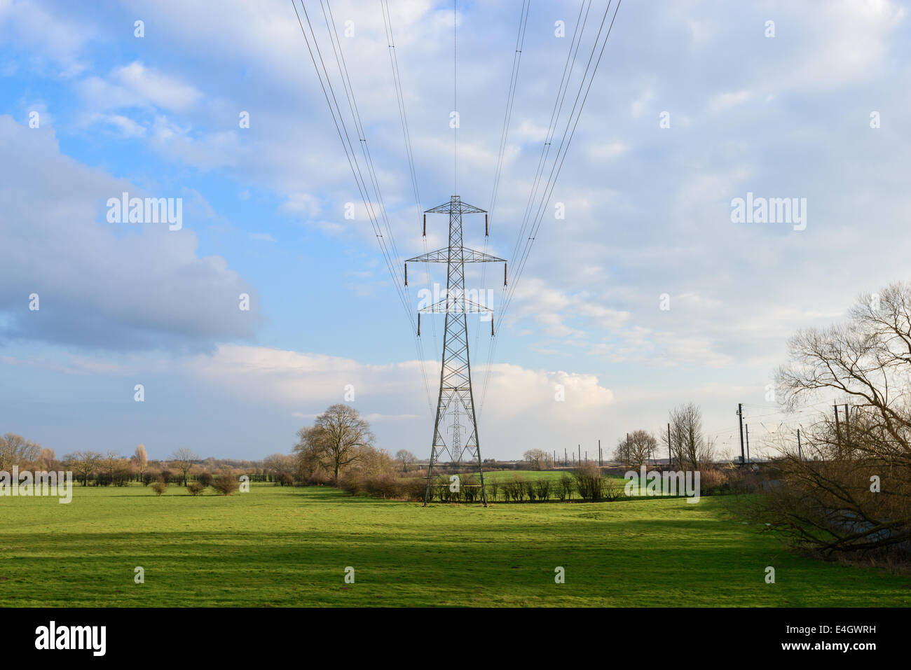 Obsolete design L6 Series suspension tower in a rural Yorkshire field, part of the National Grid. - Stock Image