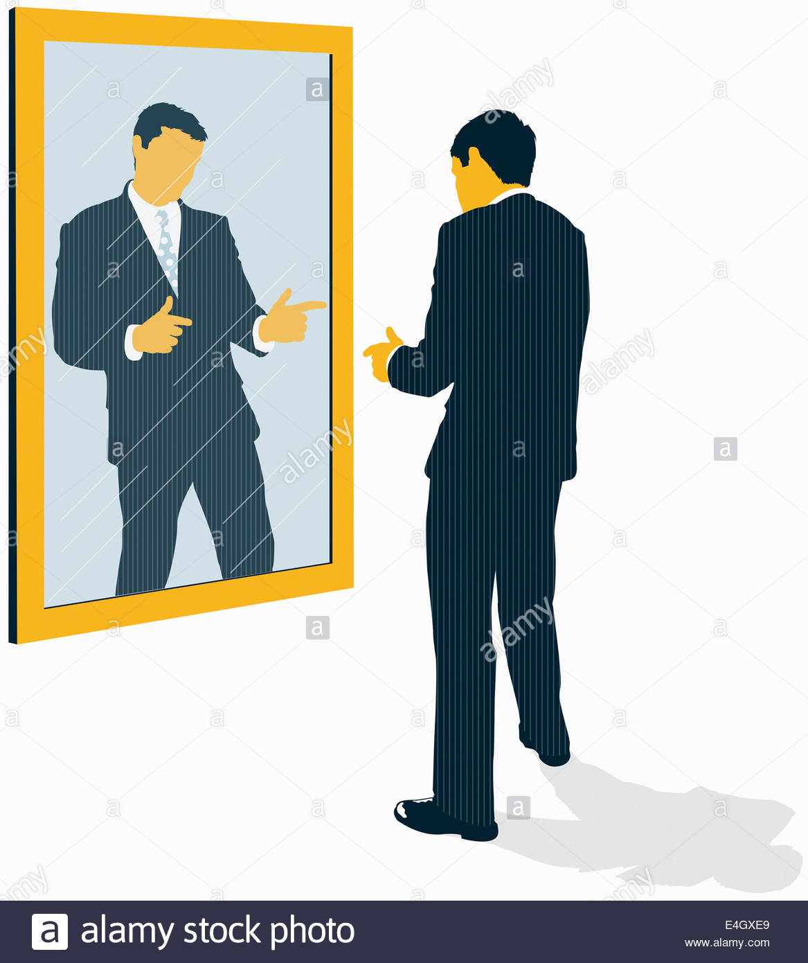 Confident businessman looking at reflection and pointing in mirror - Stock Image