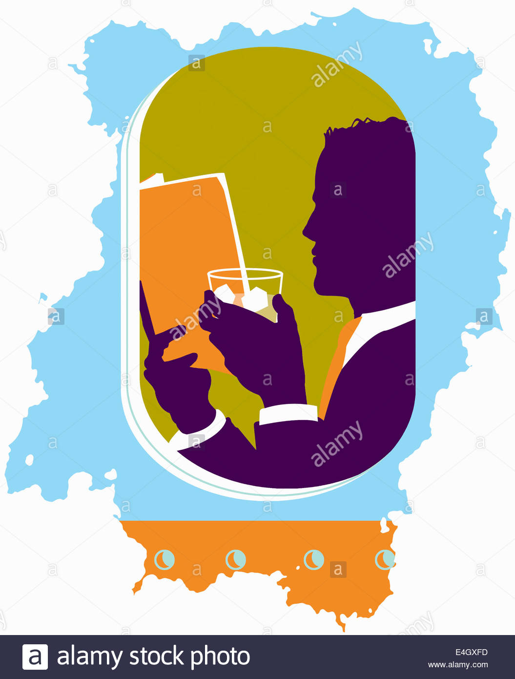 View of businessman relaxing drinking cocktail and reading book in airplane window - Stock Image