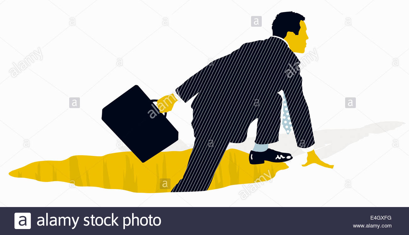 Businessman With Briefcase Climbing Out Of Hole Stock Image
