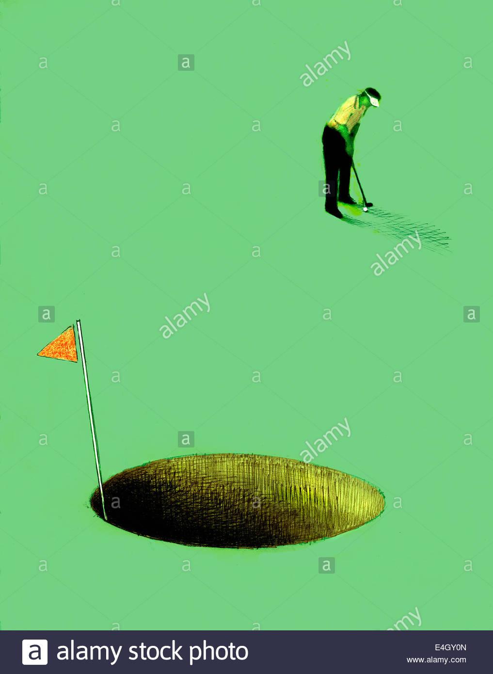 Golfer putting into oversized hole - Stock Image