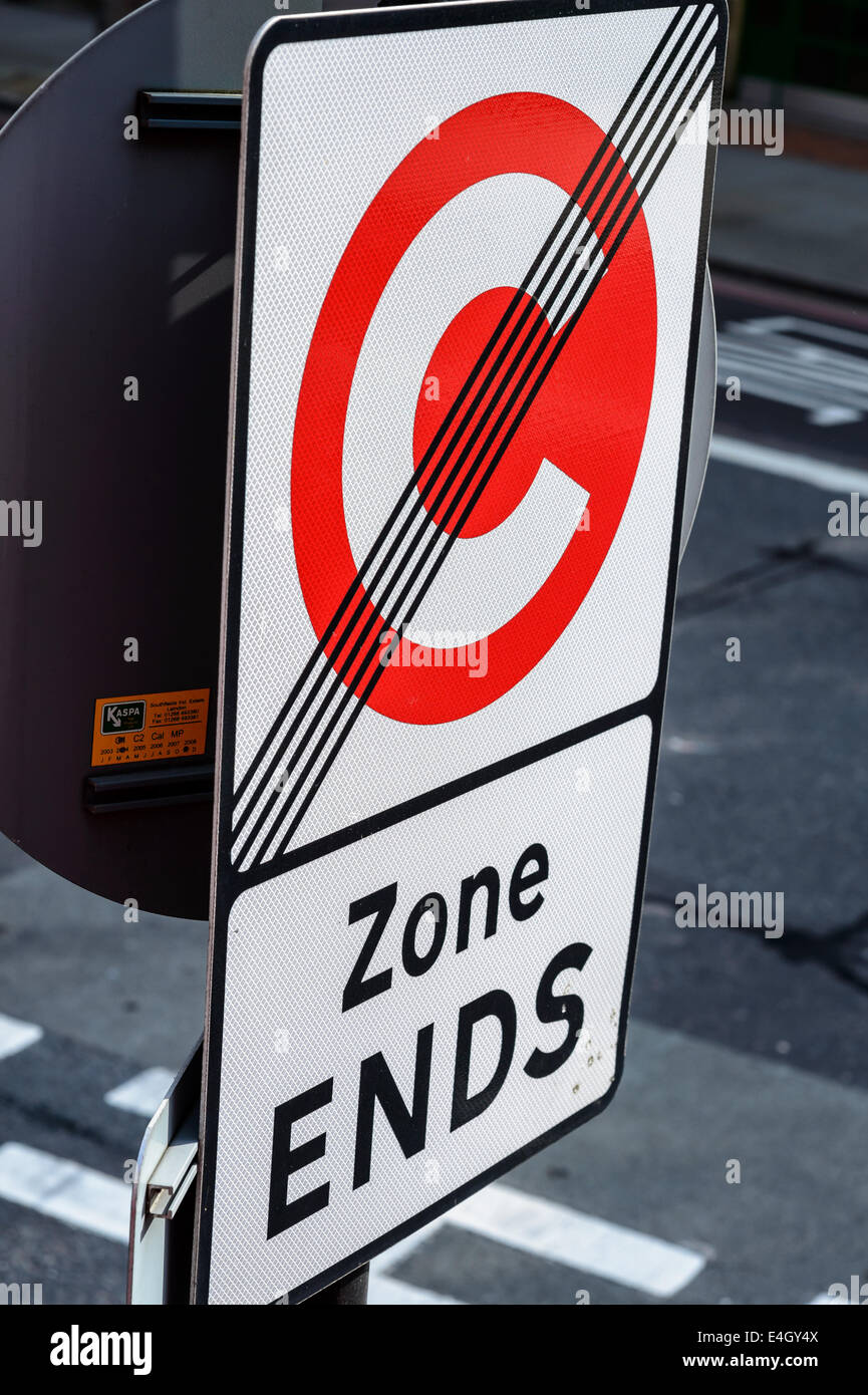 A 'Congestion Zone Ends' street sign in London UK C roundel - Stock Image