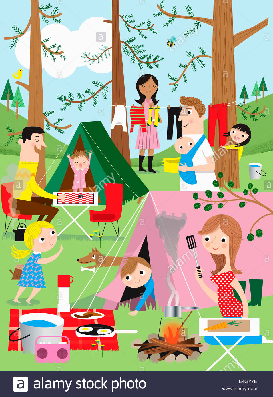Families having fun camping in woods - Stock Image