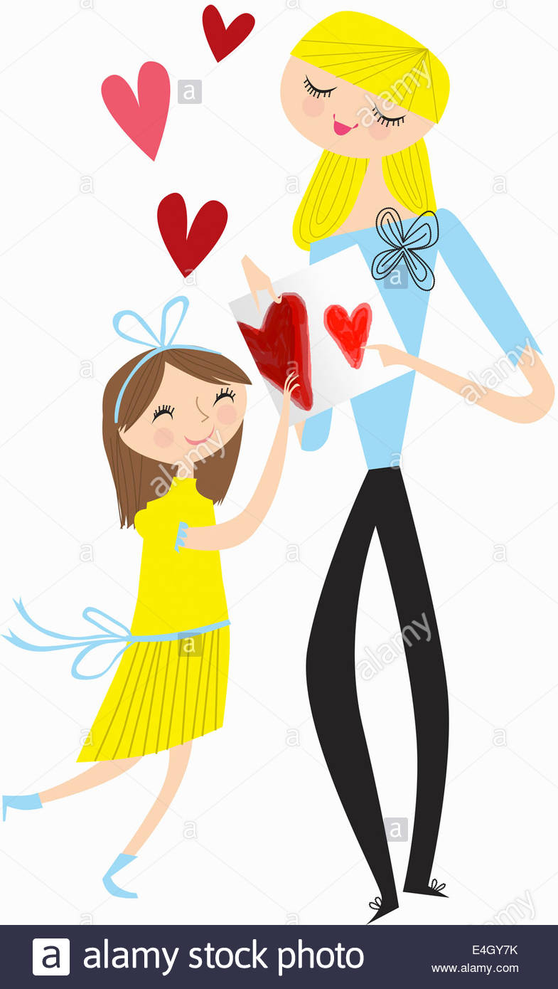 Daughter giving mother homemade Valentine's Day card - Stock Image