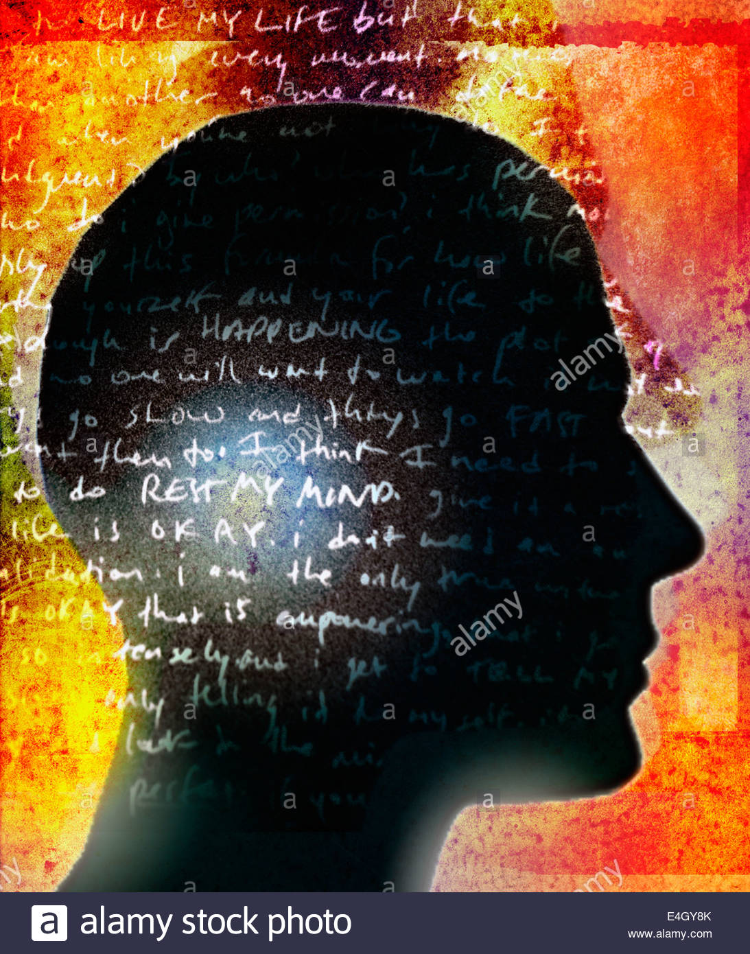 Handwritten text over silhouette profile of man's head - Stock Image