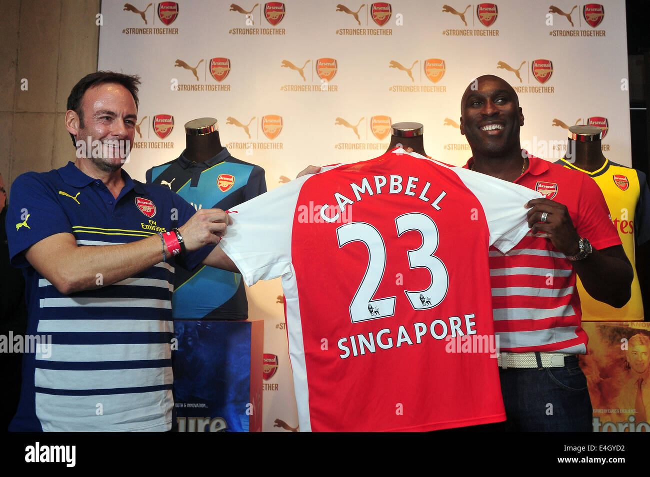 Singapore. 11th July, 2014. Former Arsenal player Sol Campbell (R) attends the Arsenal's new kit launch in Singapore, - Stock Image