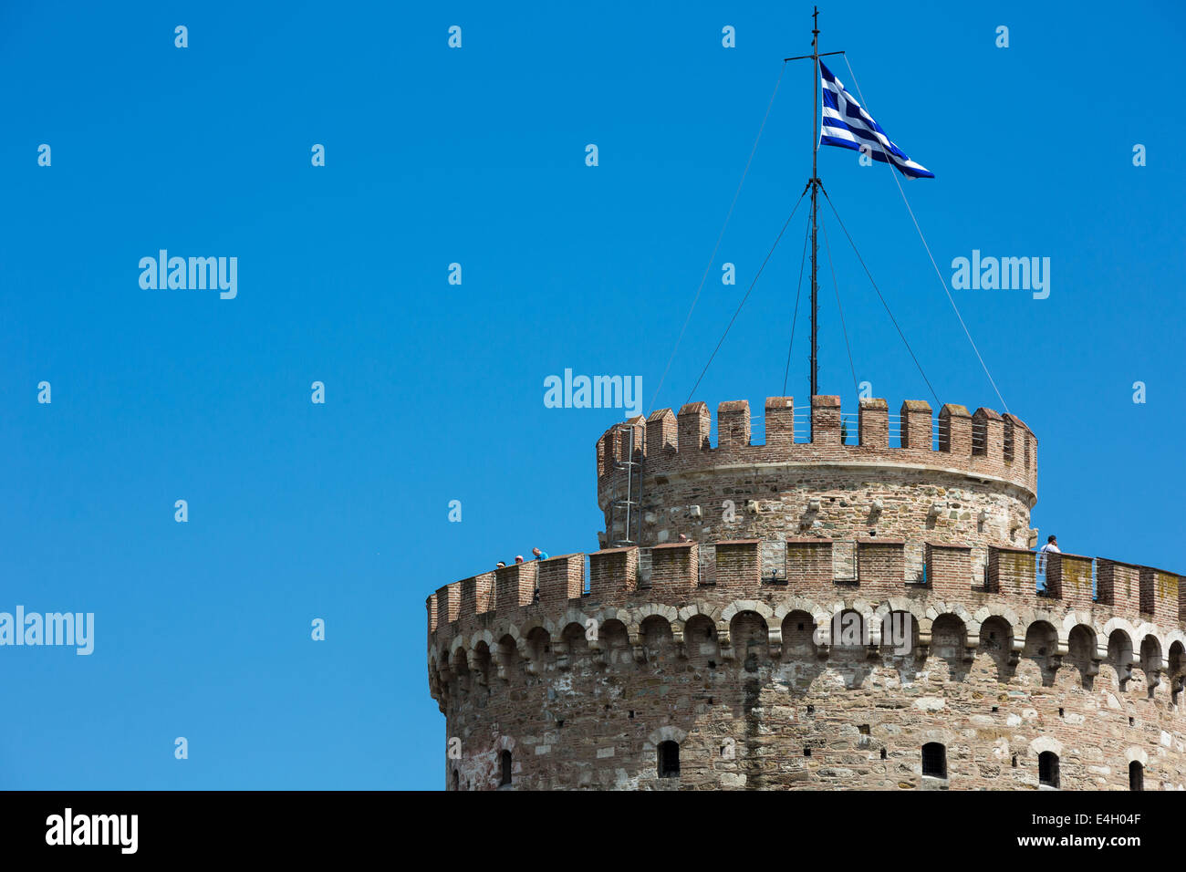 Thessaloniki, Greece. 11th July 2014. Tourists onto the city`s landmark, the White Tower in Thessaloniki, Greece. - Stock Image