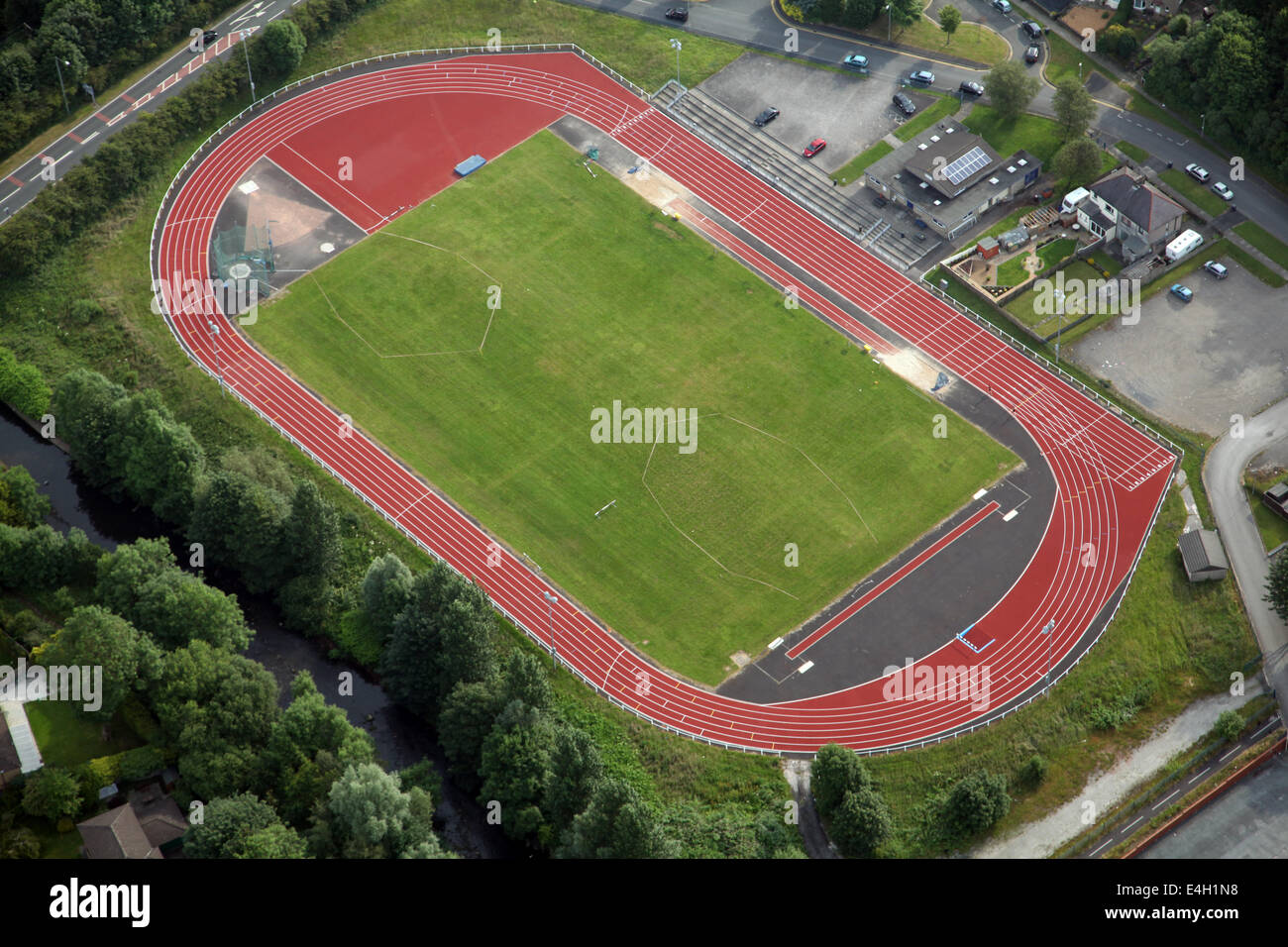 Aerial view of a red athletics running track and field. This one at Nelson, Lancashire. - Stock Image