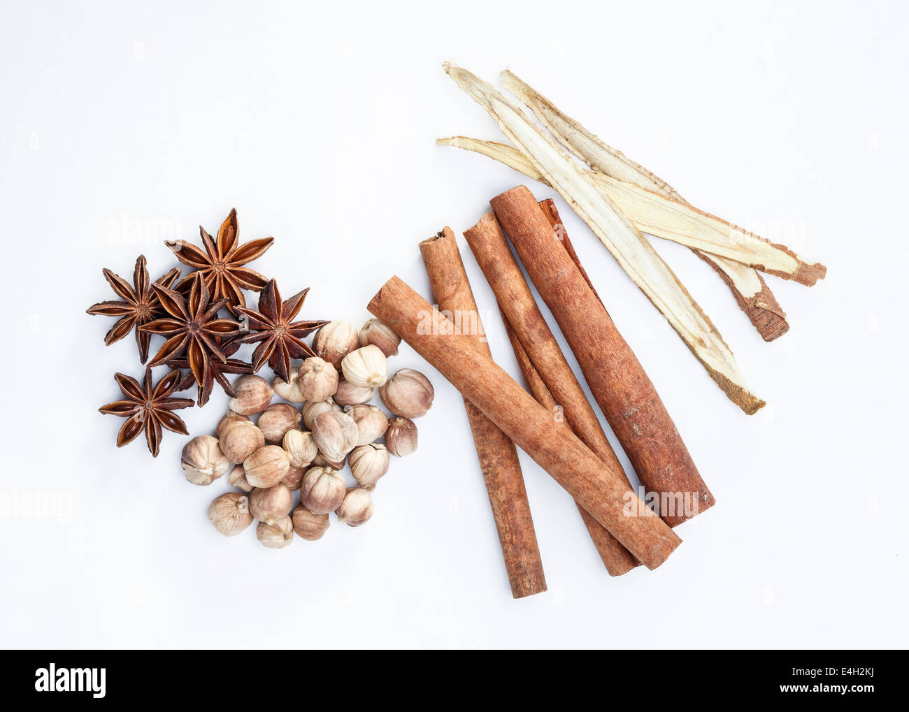 Cardamom cinnamon star aniseed and liquorice herbs for cooking isolated on white - Stock Image