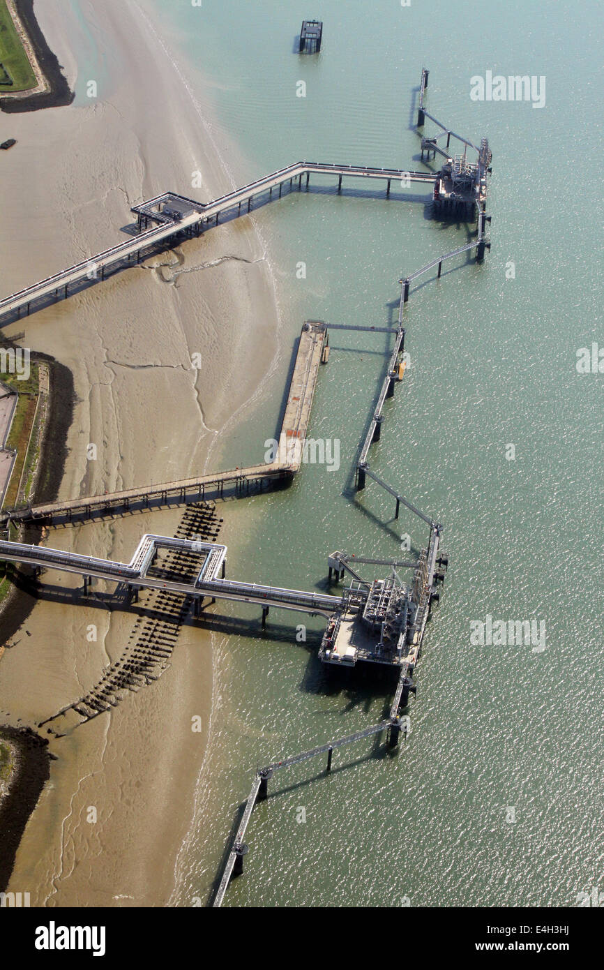 aerial view of a chemical works jetty in the River Medway, Isle of Grain, UK - Stock Image
