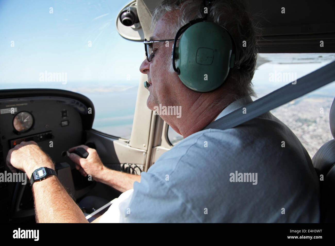 a pilot called David Hockings at the controls of his Cessna C172 flying over Essex - Stock Image
