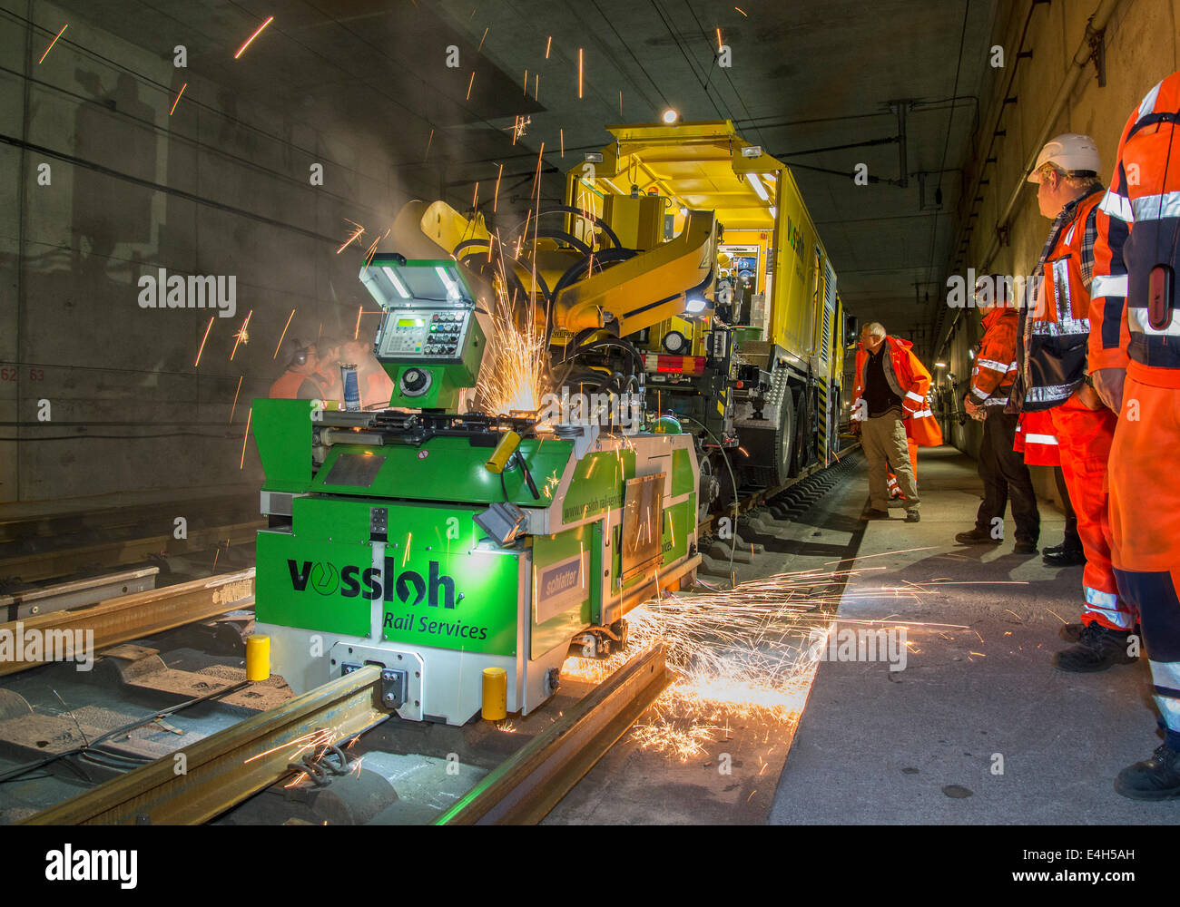 Welding machine of Vossloh Rail Services welding newly laid railroad tracks in a tunnel. Stock Photo