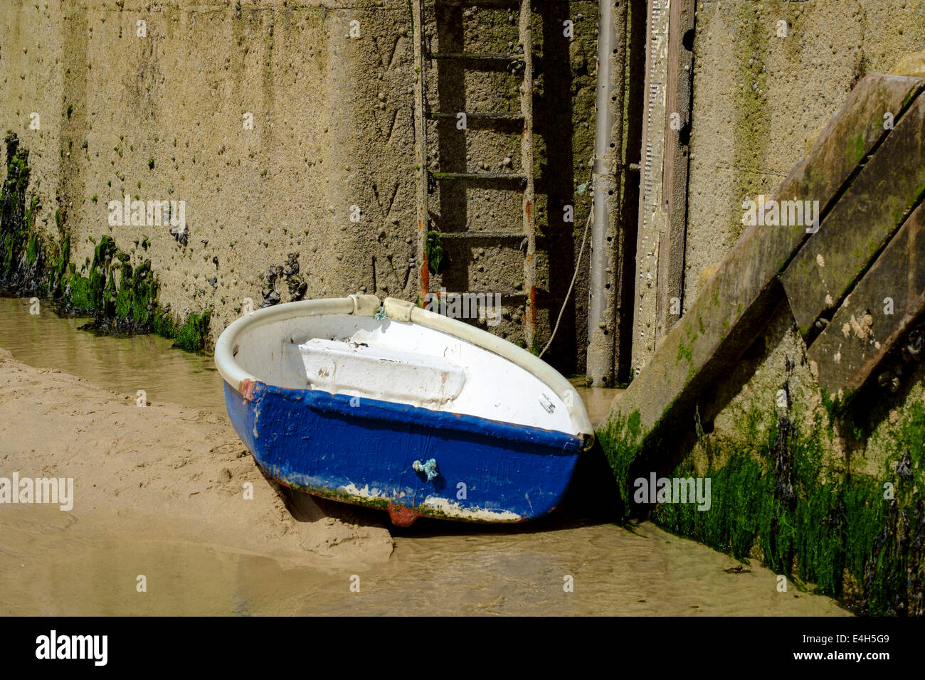 Blue and white  Rowing boat in St Ives Harbour Cornwall - Stock Image