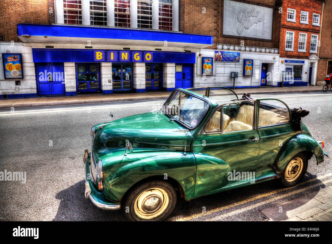 Morris Minor 1000 convertible soft top green outside gala bingo hall Worcester City UK England - Stock Image