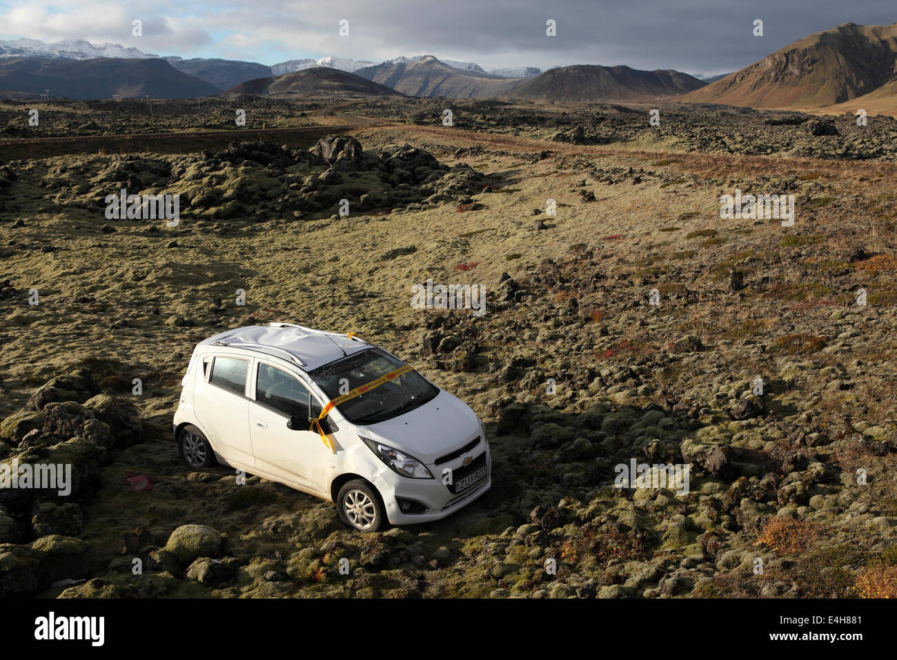 A crashed and abandoned car on the edge of the lava field at the Beserkjaravn near Bjarnahofn, Iceland. - Stock Image