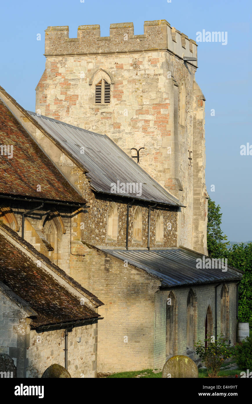 The thirteenth century tower of the Church of St Andrew, Orwell, and the Cambridgeshire countryside, Orwell, Cambridgeshire, - Stock Image