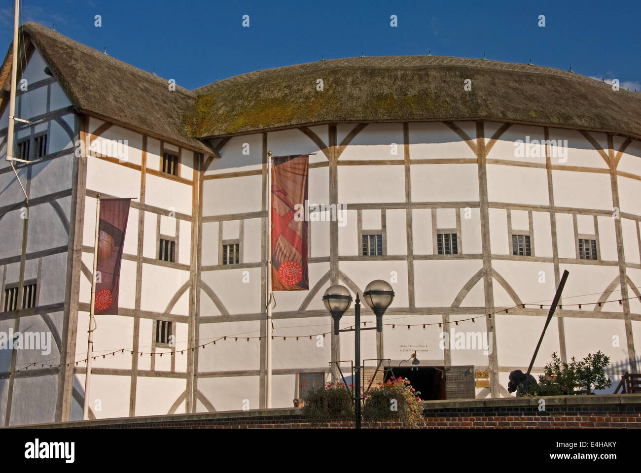 The Globe theatre stands on the South Bank of the River Thames in Central London - Stock Image