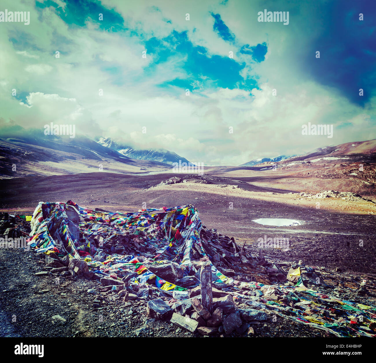 Vintage retro effect filtered hipster style travel image of Buddhist prayer flags (lungta) on Baralacha La pass - Stock Image