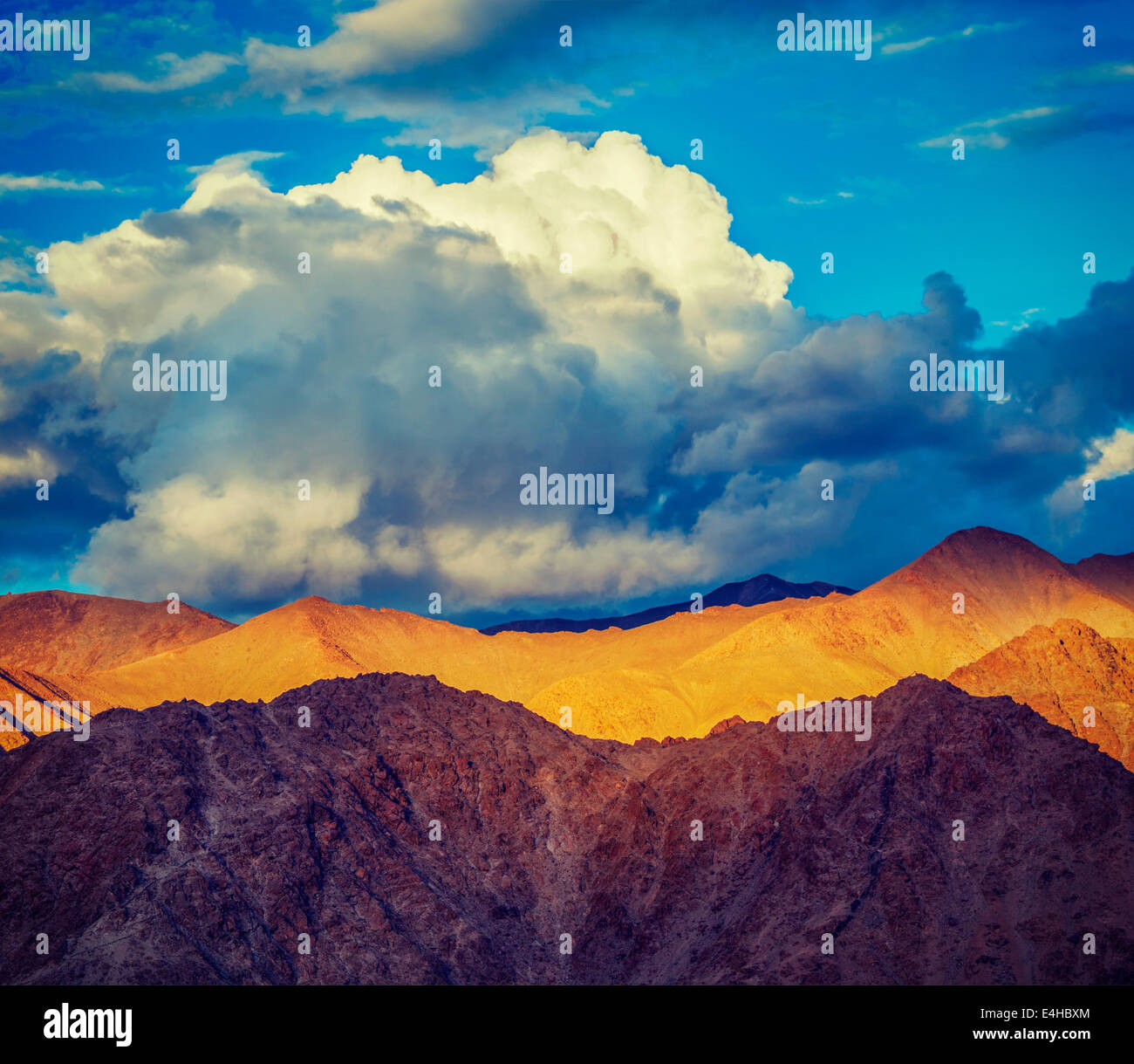 Vintage retro effect filtered hipster style travel image of Himalayas mountains on sunset. Ladakh, Jammu and Kashmir, - Stock Image