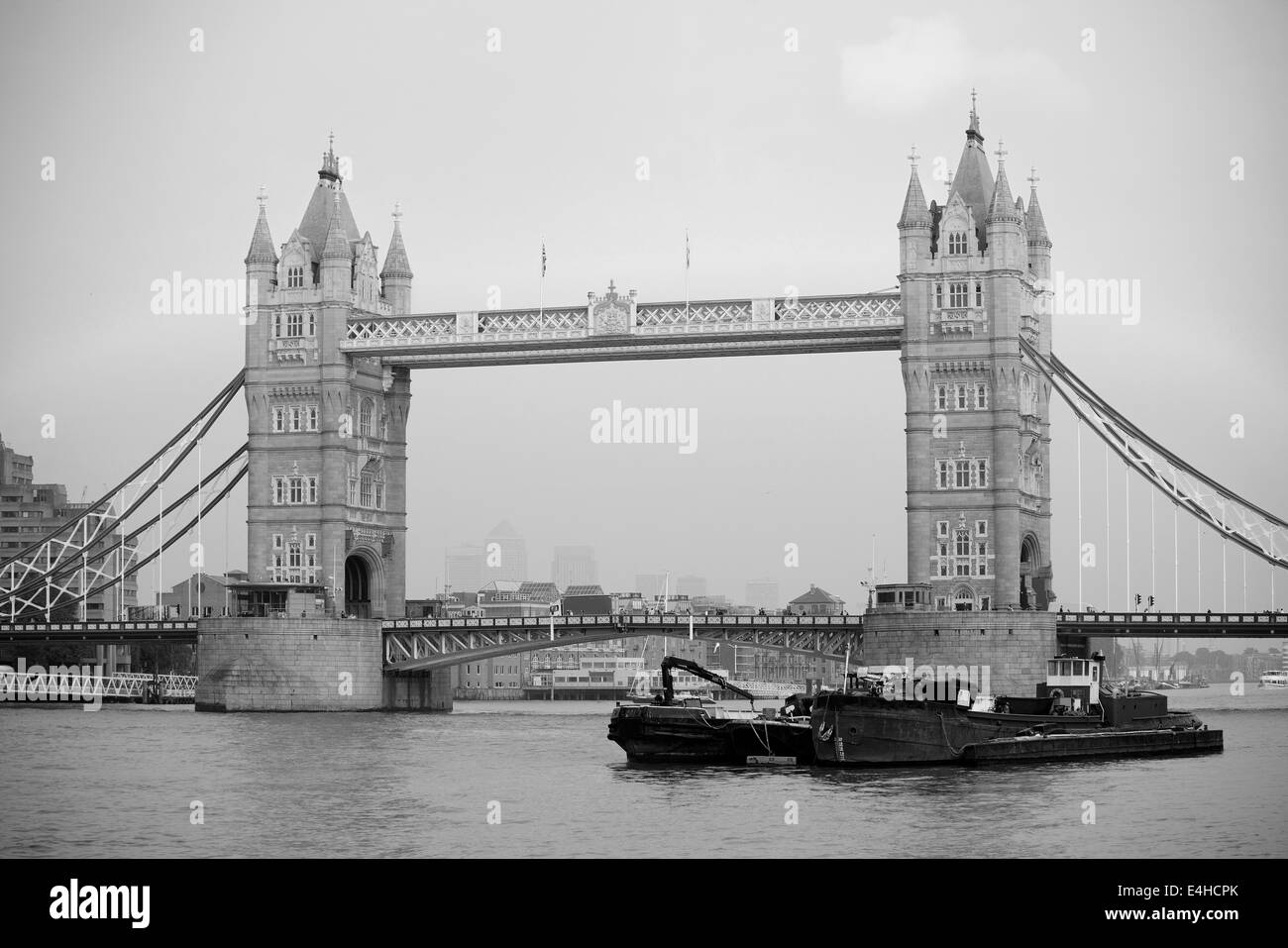 Tower Bridge black and white in London over Thames River as the famous landmark. - Stock Image