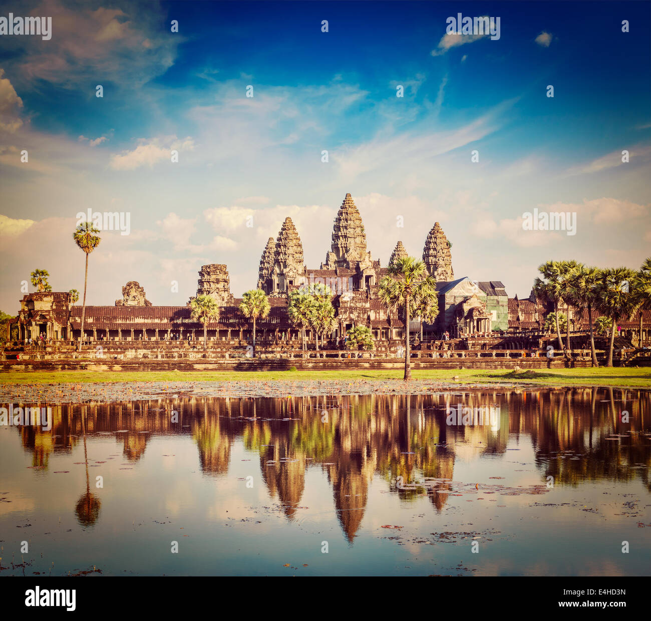 Vintage retro effect filtered hipster style travel image of Cambodia landmark Angkor Wat with reflection in water - Stock Image