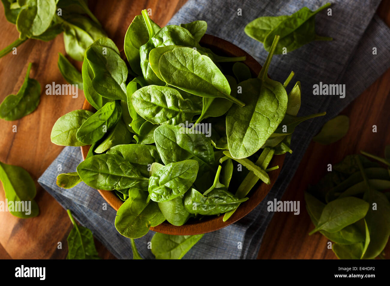 Raw Green Organic Baby Spinach in a Bowl Stock Photo