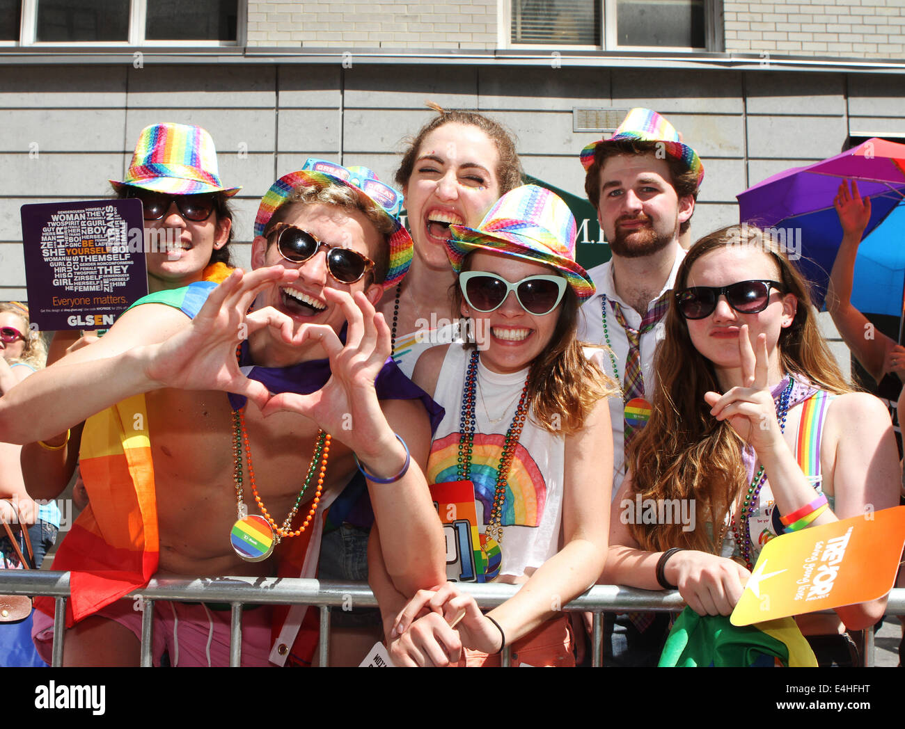 Spectators display support at 45th annual New York City Gay Pride Parade on Fifth Avenue in New York City. - Stock Image