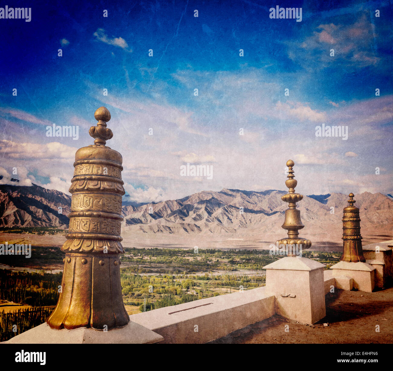 Vintage retro effect filtered hipster style travel image of Dhvaja (victory banners), on the roof of Thiksey gompa - Stock Image