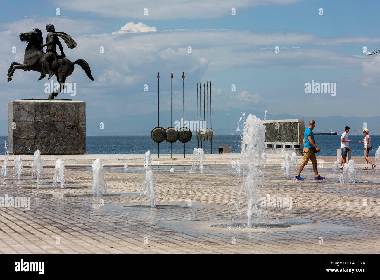 Tourist in front of a statue of Alexander the Great and his horse Bucephalus, during a sunny morning, in Thessaloniki, Stock Photo
