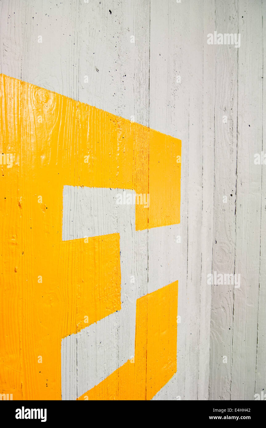 Letter E on Concrete Wall - Stock Image