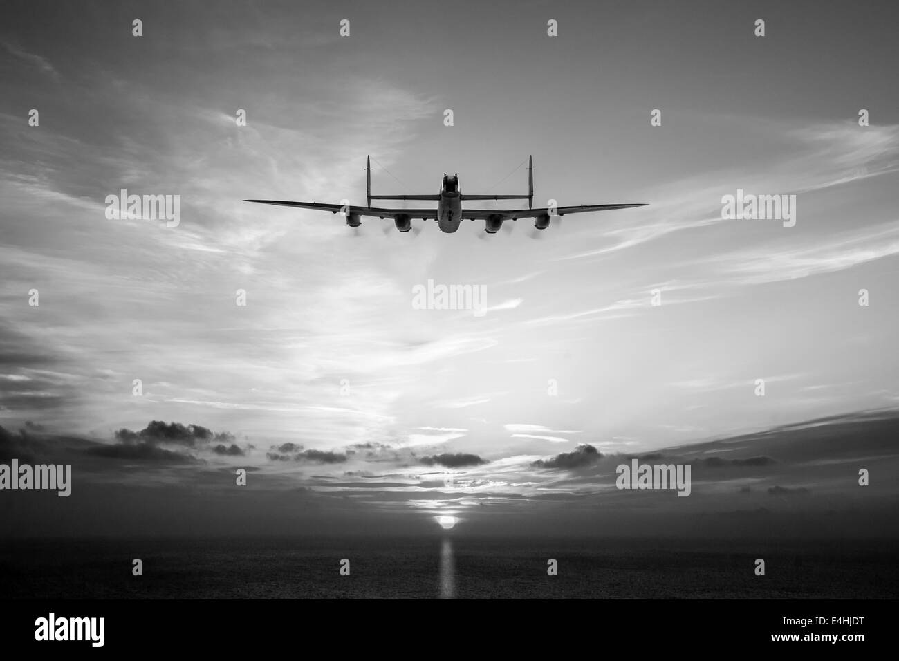 A solitary Avro Lancaster heads into the sun. Black and white version of this picture. - Stock Image