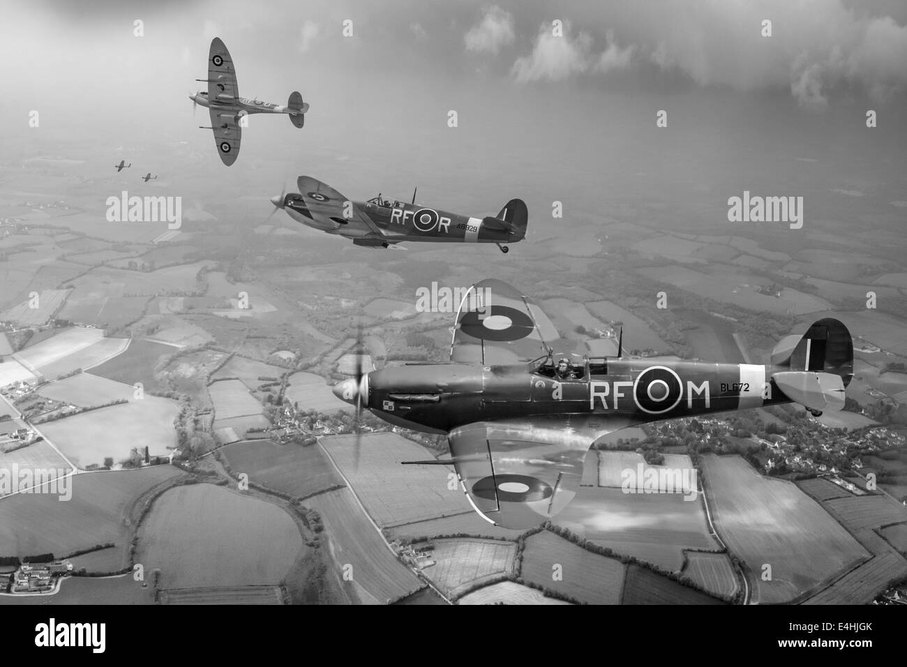 Photographic depiction of three pilots with 303 Squadron (Polish) RAF in Mk Vb Spitfires on a sweep over northern - Stock Image