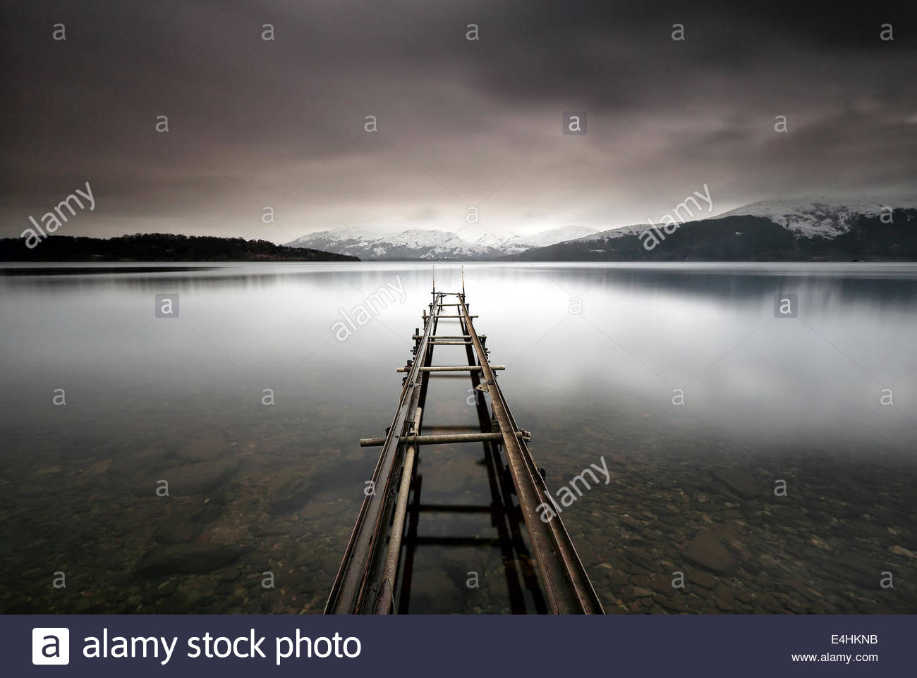 A long exposure of an abandoned jetty on the shores of Loch Lomond, Scotland - Stock Image