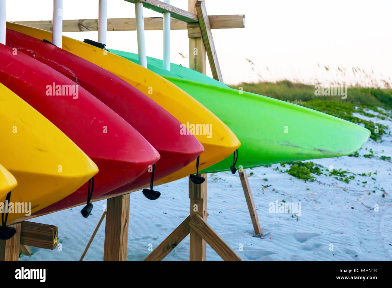 Colorful rental kayaks stored on a rack at a Key Biscayne beach in Miami, Florida, USA. Stock Photo