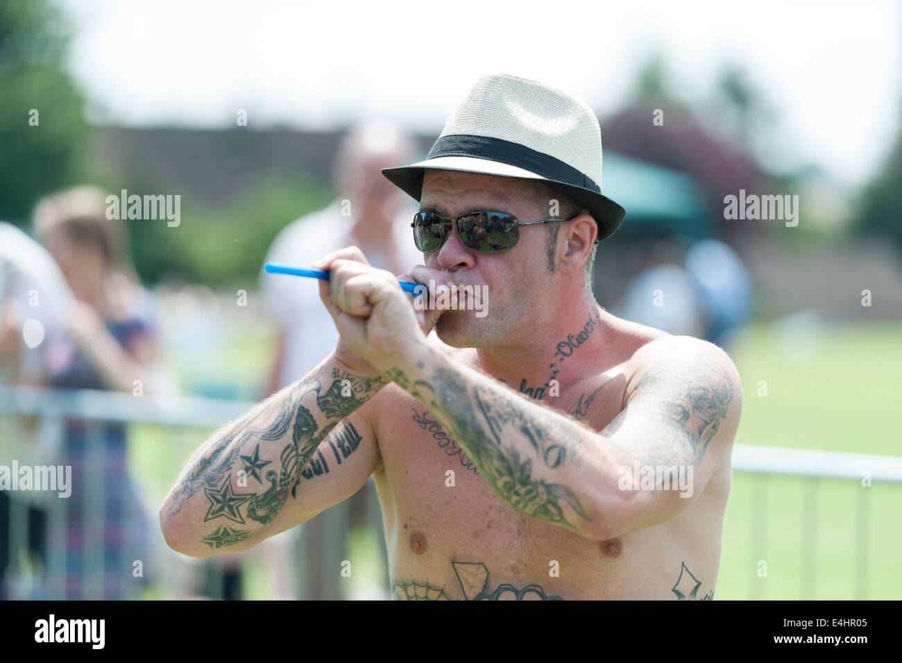Witcham near Ely Cambridgeshire UK 12th July 2014. A competitor takes part in the 44th World Pea Shooting Championships. - Stock Image
